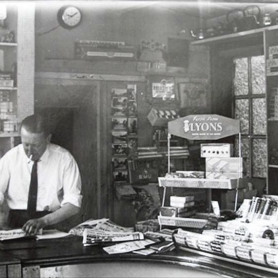 Postmaster Mr Walter Reid working in the Post Office, High Street, Meldreth.  c. 1965 | Photo supplied by Meldreth W.I.