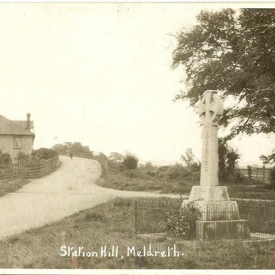 Meldreth War Memorial, 1920s.  Note the fencing around the memorial. | Bell's Postcard supplied by Ann Handscombe